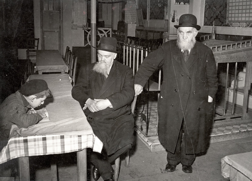 Paris, France, elderly men and a child studying in a synagogue in the Jewish quarter, May 1941